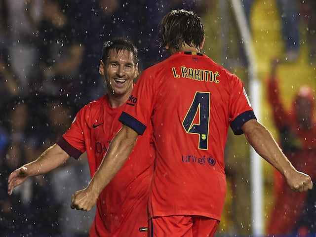 Ivan Rakitic of Barcelona celebrates scoring with his teammate Lionel Messi during the La Liga match against Levante on September 21, 2014