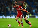 Cardiff player John Brayford (l) is challenged by Adam Clayton of Middlesbrough during the Sky Bet Championship match on September 16, 2014