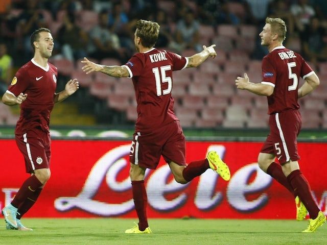 Sparta Prague's Czech midfielder Josef Husbauer (2ndR) celebrates with teammates after scoring during the UEFA Europa League Group I football match against SSC Napoli on September 18, 2014