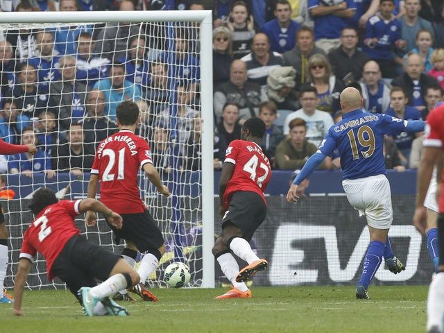 Leicester City's Argentinian midfielder Esteban Cambiasso scores their third goal during the English Premier League football match between Leicester City and Manchester United at the King Power Stadium in Leicester on September 21, 2014