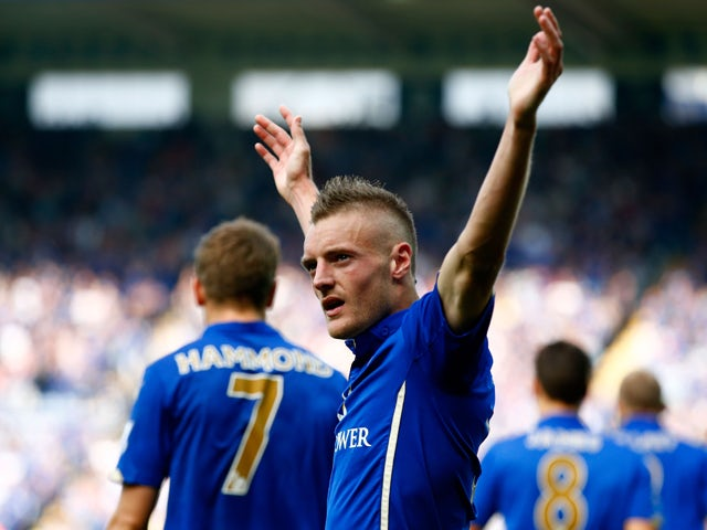 Jamie Vardy of Leicester City celebrates after scoring his team's fourth goal during the Barclays Premier League match between Leicester City and Manchester United at The King Power Stadium on September 21, 2014