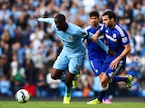 Yaya Toure of Manchester City competes with Cesc Fabregas of Chelsea during the Barclays Premier League match between Manchester City and Chelsea at the Etihad Stadium on September 21, 2014