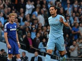 Manchester City's English midfielder Frank Lampard acknowledges the crowd after scoring his goal during the English Premier League football match between Manchester City and Chelsea at the Etihad Stadium in Manchester on September 21, 2014