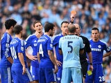 Referee Mike Dean shows a red card to Pablo Zabaleta of Manchester City during the Barclays Premier League match between Manchester City and Chelsea at the Etihad Stadium on September 21, 2014