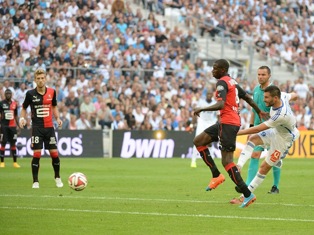 Marseille's French forward Andre-Pierre Gignac scores his second goal during the French L1 football match Olympique of Marseille (OM) versus Rennes at the Velodrome stadium in Marseille, on September 20, 2014