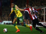 Martin Olsson of Norwich attacks during the Sky Bet Championship match between Brentford and Norwich City at Griffin Park on September 16, 2014