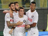 Inter Milan's Croatian midfielder Mateo Kovacic is congratulated after scoring during the Serie A football match Palermo vs Inter Milan at Renzo Barbera Stadium in Palermo on September 21, 2014