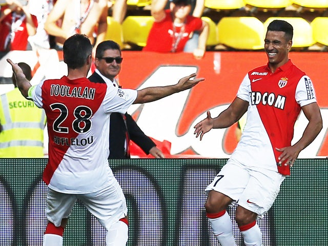 Monaco's Moroccan midfielder Nabil Dirar celebrates after scoring a goal with Monaco's French midfielder Jeremy Toulalan during the French L1 football match Monaco (ASM) vs Guingamp (EAG) on September 21, 2014