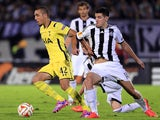 Nabil Bentaleb (L) of Tottenham Hotspur is challenged by Petar Grbic (R) of Partizan during the UEFA Europa League match between Partizan and Tottenham Hotspur on September 18, 2014