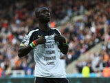 Papiss Cisse of Newcastle United shows his siupport to team mate Jonas Gutierrez after scoring his second goal during the Barclays Premier League match between Newcastle United and Hull City at St James' Park on September 20, 2014