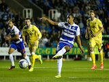 Nick Blackman scores his team's second goal of the game during the Sky Bet Championship match between Reading and Millwall at Madejski Stadium on September 16, 2014