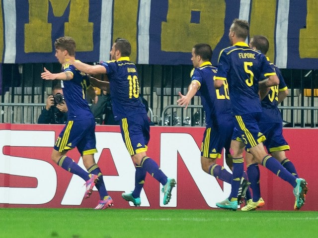 NK Maribor's players celebrate after scoring during the UEFA Group G Champions League footbal match NK Maribor vs Sporting Lisbon in Maribor, Slovenia on September 17, 2014