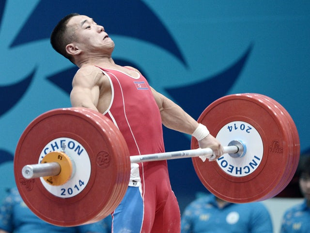 Gold medalist Om Yun-Chol of North Korea attempts a lift in the men's 56kg weightlifting event during the 2014 Asian Games in Incheon on September 20, 2014
