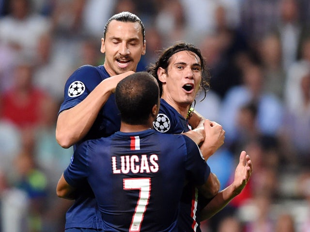 Paris Saint-Germain's Edinson Cavani celebrates with teammates Zlatan Ibrahimovic and Lucas after scoring during the UEFA Champions League football match Ajax Amsterdam vs Paris Saint-Germain (PSG) in Amsterdam, on September 17, 2014