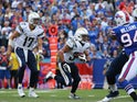 Philip Rivers #17 of the San Diego Chargers hands off to Donald Brown against the Buffalo Bills on September 21, 2014
