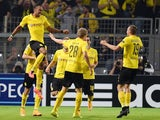 Dortmund's Gabonese striker Pierre-Emerick Aubameyang (L) celebrates scoring with his teammates during the first leg UEFA Champions League Group D football match against Arsenal on September 16, 2014