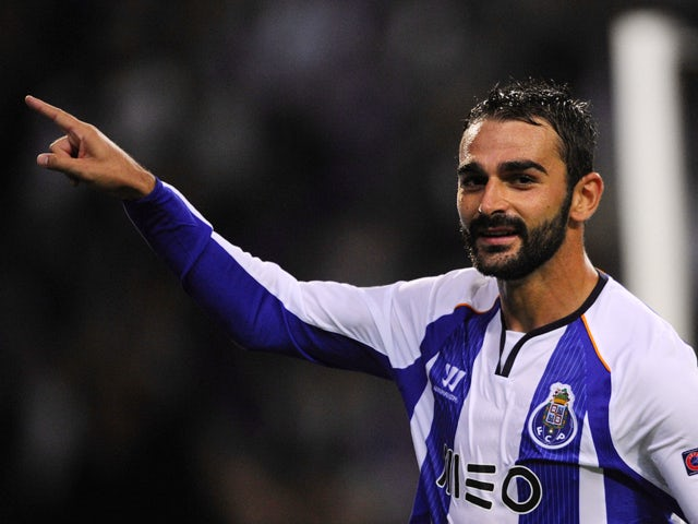 Porto's Spanish forward Adrian Lopez celebrates after scoring during the UEFA Champions League football match FC Porto vs FC Bate Borisov at the Dragao stadium in Porto on September 17, 2014