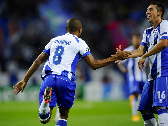 Porto's French-born Algerian midfielder Yacine Brahimi celebrates with his teammate Mexican midfielder Hector Herrera after scoring during the UEFA Champions League football match FC Porto vs FC BATE Borisov at the Dragao stadium in Porto on September 17,