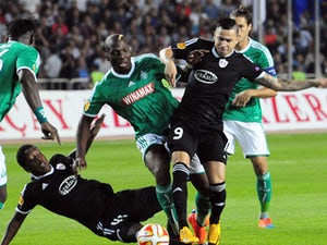Renaud Cohade of Saint-Etienne vies for a ball with Reynaldo and Leroy George of Qarabag FK from Agdam, on September 18, 2014