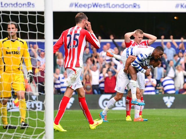 Steven Caulker of QPR is congratulated by Leroy Fer after scoring his team's opening goal during the Barclays Premier League match between Queens Park Rangers and Stoke City at Loftus Road on September 20, 2014
