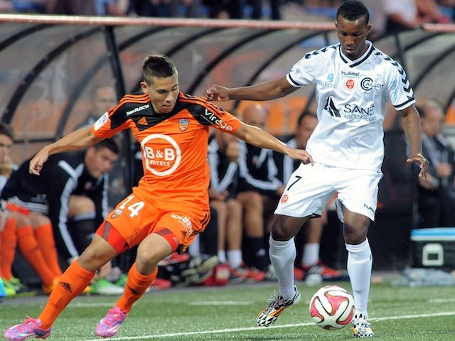 Lorient's French Portuguese defender Raphael Guerreiro (L) vies with Reims' Cape Verdean forward Odair Fortes during the French L1 football match between Lorient and Reims on September 20, 2014