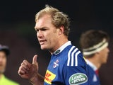 Stormers captain Schalk Burger chats to Referee Jaco Peyper during the Super Rugby match between DHL Stormers and Cell C Sharks at DHL Newlands Stadium on July 12, 2014