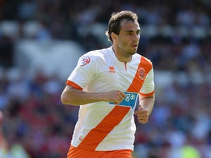 Sergei Zenjov of Blackpool during the Sky Bet Championship match between Nottingham Forest and Blackpool at City Ground on August 9, 2014