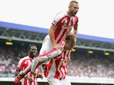 Peter Crouch of Stoke City celebrates his goal with Phil Bardsley of Stoke City during the Barclays Premier League match between Queens Park Rangers and Stoke City at Loftus Road on September 20, 2014