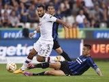 Torino forward Babio Quagliarella fights vies with Club Brugge's defender Oscar Duarte on September 18, 2014
