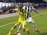 Harry Kane of Tottenham Hotspur is challenged by Danilo Pantic of Partizan during the UEFA Europa League match between Partizan and Tottenham Hotspur at the Stadium JNA on September 18, 2014