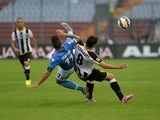 Bruno Fernandes Borges of Udinese Calcio battles for the ball with Christian Maggio of SSC Napoli the Serie A match between Udinese Calcio and SSC Napoli at Stadio Friuli on September 21, 2014
