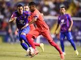 Levante's midfielder Victor Camarasa (L) vies with Barcelona's Brazilian forward Neymar da Silva Santos Junior during the Spanish league football match on September 21, 2014