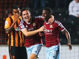 Enner Valencia of West Ham United celebrates with team mate Stewart Downing of West Ham United as he scores their first goal during Barclays Premier League match between Hull City and West Ham United at KC Stadium on September 15, 2014