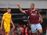 West Ham United's New Zealand defender Winston Reid celebrates scoring the opening goal as Liverpool's English midfielder Steven Gerrard (L) look son during the English Premier League football match between West Ham United and Liverpool at The Boleyn Grou