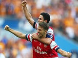 Aaron Ramsey (L) and Mikel Arteta of Arsenal (R) celebrate victory after the FA Cup with Budweiser Final match between Arsenal and Hull City at Wembley Stadium on May 17, 2014
