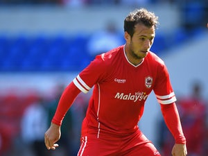Adam Le Fondre of Cardiff in action during the friendly match between Cardiff City and VFL Wolfsburg at Cardiff City Stadium on August 2, 2014
