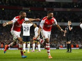 Arsenals English striker Alex Oxlade-Chamberlain (2-L) celebrates scoring a goal during the English Premier League football match between Arsenal and Tottenham Hotspur on September 27, 2014