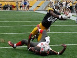 Antonio Brown #84 of the Pittsburgh Steelers catches his second touchdown of the game in front of Alterraun Verner #21 of the Tampa Bay Buccaneers on September 28, 2014
