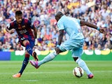 Neymar of FC Barcelona scores the opening goal past Diego Mainz of Granda CF during the La Liga match between FC Barcelona and Granada CF at Camp Nou on September 27, 2014