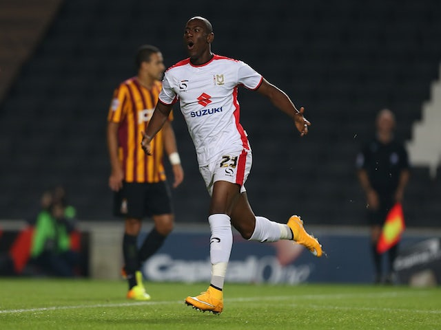 Benik Afobe of MK Dons celebrates after scoring his sides 1st goal during the Capital One Cup Third Round match between MK Dons and Bradford City on September 23, 2014