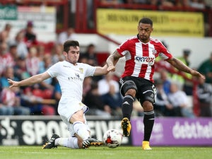 Andre Gray of Brentford tackles Lewis Cook of Leeds during the Sky Bet Championship match between Brentford and Leeds United at Griffin Park on September 27, 2014