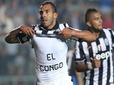 Juventus' Argentinian forward Carlos Tevez celebrates showing the inscription 'El Congo' on his jersey after scoring during the Italian Serie A football match against Atalanta on September 27, 2014