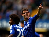 Oscar of Chelsea celebrates after scoring the opening goal during the Barclays Premier League match between Chelsea and Aston Villa at Stamford Bridge on September 27, 2014