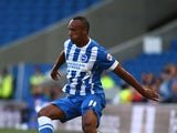 Chris O'Grady of Brighton looks to get past Jack Deaman of Cheltenham during the Capital One Cup First Round match between Brighton & Hove Albion and Cheltenham Town at The Amex Stadium on August 12, 2014