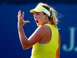 Coco Vandeweghe of the United States reacts against Donna Vekic of Croatia during her women's singles first round match on Day Two of the 2014 US Open at the USTA Billie Jean King National Tennis Center on August 26, 2014