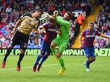 Julian Speroni of Crystal Palace makes as Leonardo Ulloa of Leicester City heads the ball towards goal during the Barclays Premier League match between Crystal Palace and Leicester City at Selhurst Park on September 27, 2014