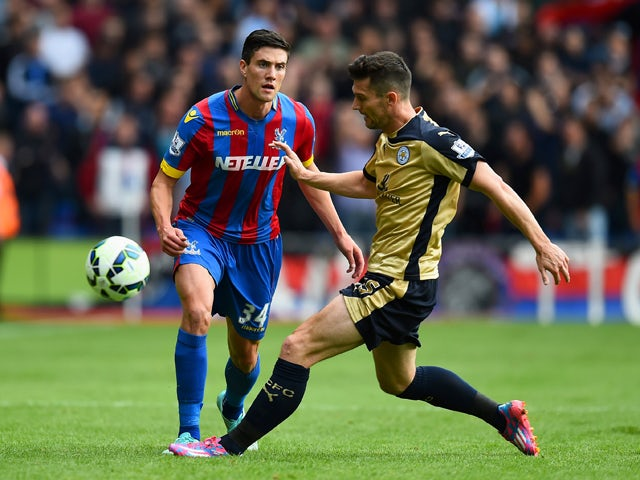 Martin Kelly of Crystal Palace battles for the ball with David Nugent of Leicester City during the Barclays Premier League match between Crystal Palace and Leicester City at Selhurst Park on September 27, 2014