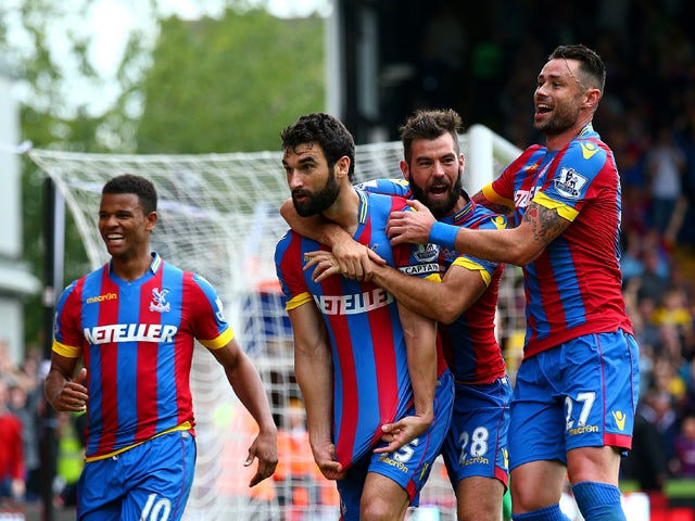Mile Jedinak of Crystal Palace celebrates with team-mates after scoring his team's second goal during the Barclays Premier League match between Crystal Palace and Leicester City at Selhurst Park on September 27, 2014