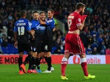 Dan Gosling of Bournemouth (C) celebrates with his team mates after scoring his side's third goal during the Capital One Cup third round match against Cardiff City on September 23, 2014