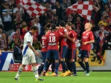 Lille's Belgium forward Divock Origi is congratuled by his teammates after scoring a goal during the French L1 football match Lille vs Bastia on September 27, 2014